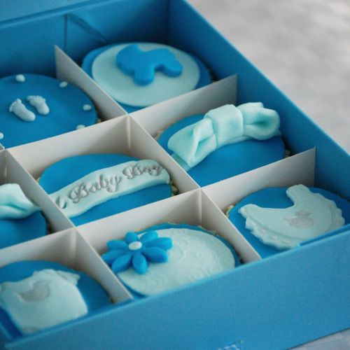 A #Personalised #Cupcake Gift Box, a delicious way to celebrate the arrival of a New #Baby. We wonder if the Duchess of Cambridge received some of these! A collection of 6 or 9 handmade sponge cakes are beautifully covered in delicious buttercream, topped with soft fondant and decorated by hand to perfection. Add a #personalised message to make this a unique gift (and a much-needed sweet treat for new parents).