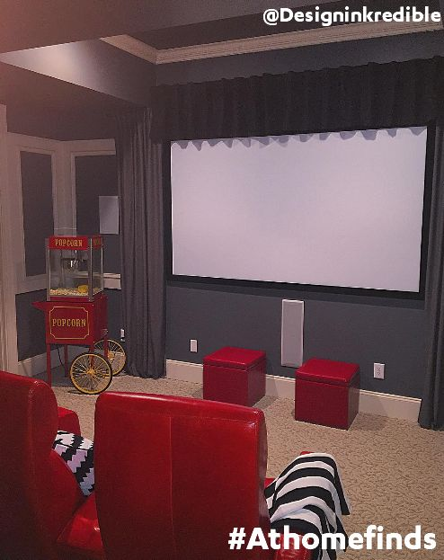 Turn Your Basement Or Den Into A Home Theater With Comfy Red Chairs And Ottomans