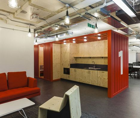Informal meeting rooms and small kitchens are contained within shipping containers, as are the lockers. Google Campus by Jump Studios