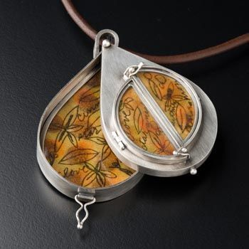 Nancy Bonnema: In sterling silver and enamel on copper, containing cardamom seeds.