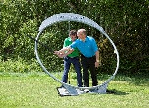 Luther Blacklock PGA Master Pro giving a lesson on the Explanar golf training aid