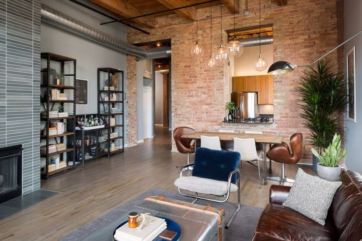 Loft industrial em Chicago - Superior St. por Haven Design Studio
