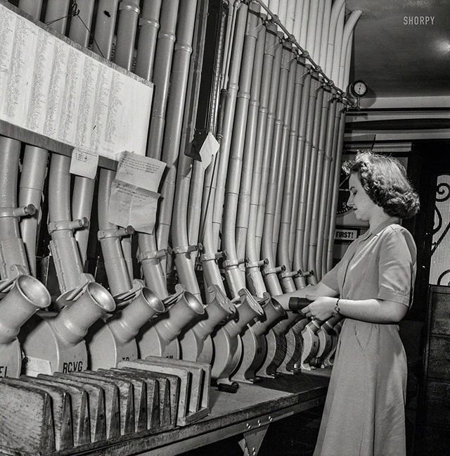 Miss Helen Ringwald, employee at the Western Union telegraph office, works with the pneumatic tubes through which messages are sent to branches in other parts of the city for delivery. Washington, D.C., June 1943 .. #history #viralnetics #washingtondc