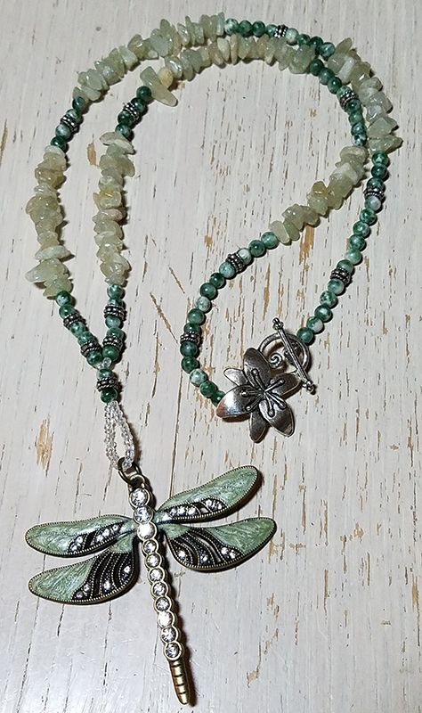 BSBP REVEAL! This is my favorite piece! I love dragonflies and having been eying this particular pendant! The dragon fly is beautiful with the enameling and rhinestones. I strung it with a loop made of glass seed beads, aquamarine chips, tree jade and a few touches of silver plated beads then finished with a silver plated floral clasp. Thank you Jackie!