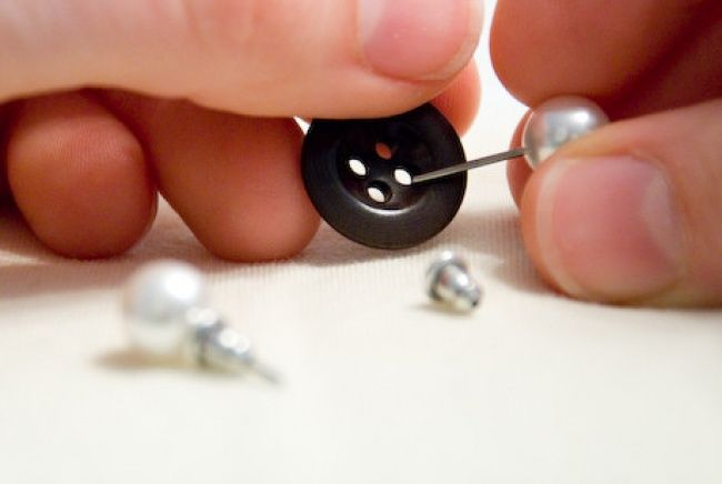 Use buttons to pair earrings, especially small ones, and prevent them from getting lost.