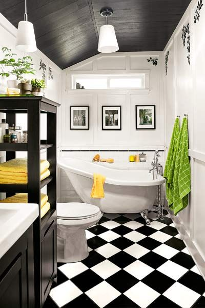 guest bath after redo with black and white tile, soaking tub, white paneled walls, small bathroom design ideas
