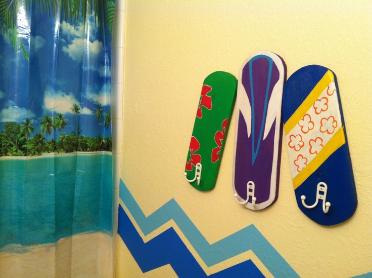 Surf themed bathroom. Towel hangers made from leftover wood. I would totally write their names on them:)