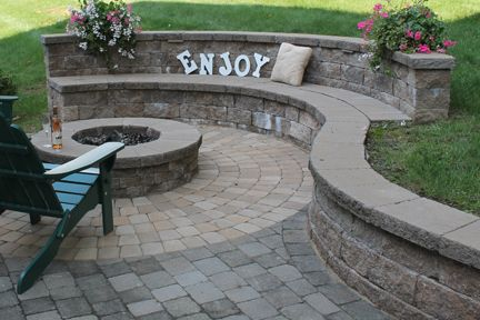 Retaining Wall Bench | Sitting walls may also be built in such a way to incorporate a back ...