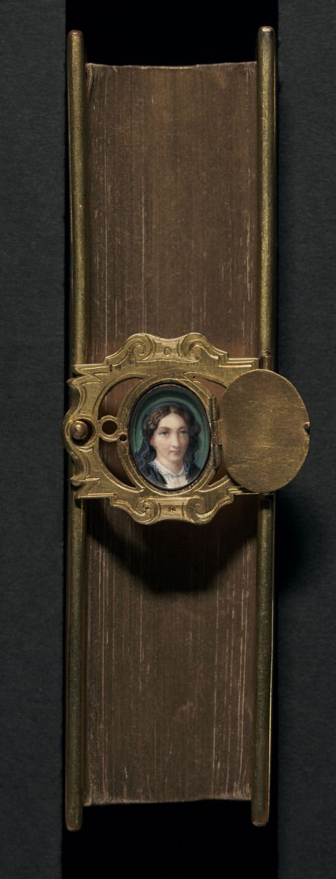 The woman pictured in the miniature is possibly Carrie Wilkie's mother. Bound in Oxford or London by Hayday.