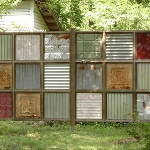 Interesting fence- reuse of corrugated steel and old tin ceiling tiles.
