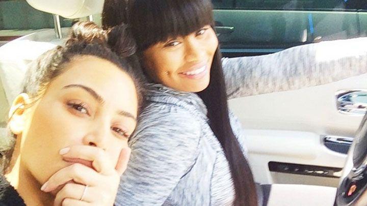 Kim Kardashian takes a selfie with Blac Chyna while driving June 6, 2014.   - MarieClaire.com