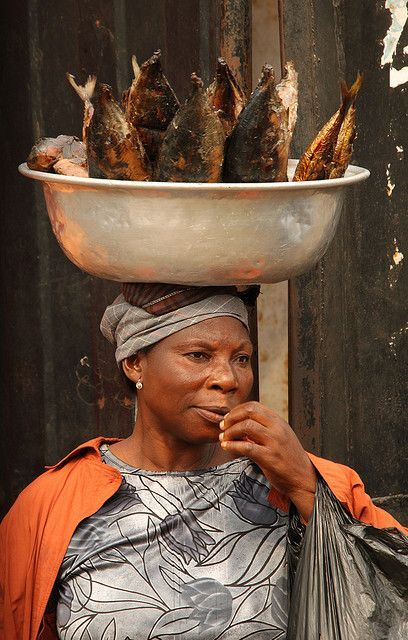 Ghana - Accra - Woman selling smoked fish. The colors! Accomplished without thought. (Maybe Photoshop?)