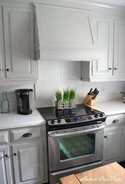 We have the same cabinets.  Replace microwave with similar hood. add hardware and new counters.