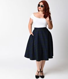 Pretty in plaid, darling! A plus size vintage inspired swing skirt from Hell Bunny, the Doralee skirt is a magnificent navy blue and emerald green plaid wardrobe staple! Crafted in a retro inspired silhouette and featuring a flattering high waist design a