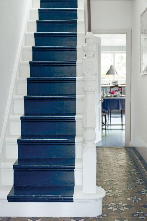 Painting the steps of a staircase. Simle and clean. An effective way to compliment Victorian encaustic tiles especially by picking out an accent colour. In this case the cerulean blue. Or on a plain floor, erhaps pick out a colour from a beautiful runner. R McN