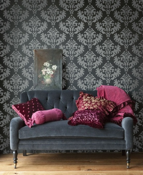 Damask wall paper, black with black sofa and burgundy accents