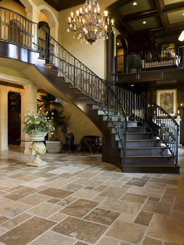 #Travertine tiles add a regal elegance to this opulent hallway and offset the dark stair case and soft lighting #designideas #interiordesign #homes #flooring #tiles