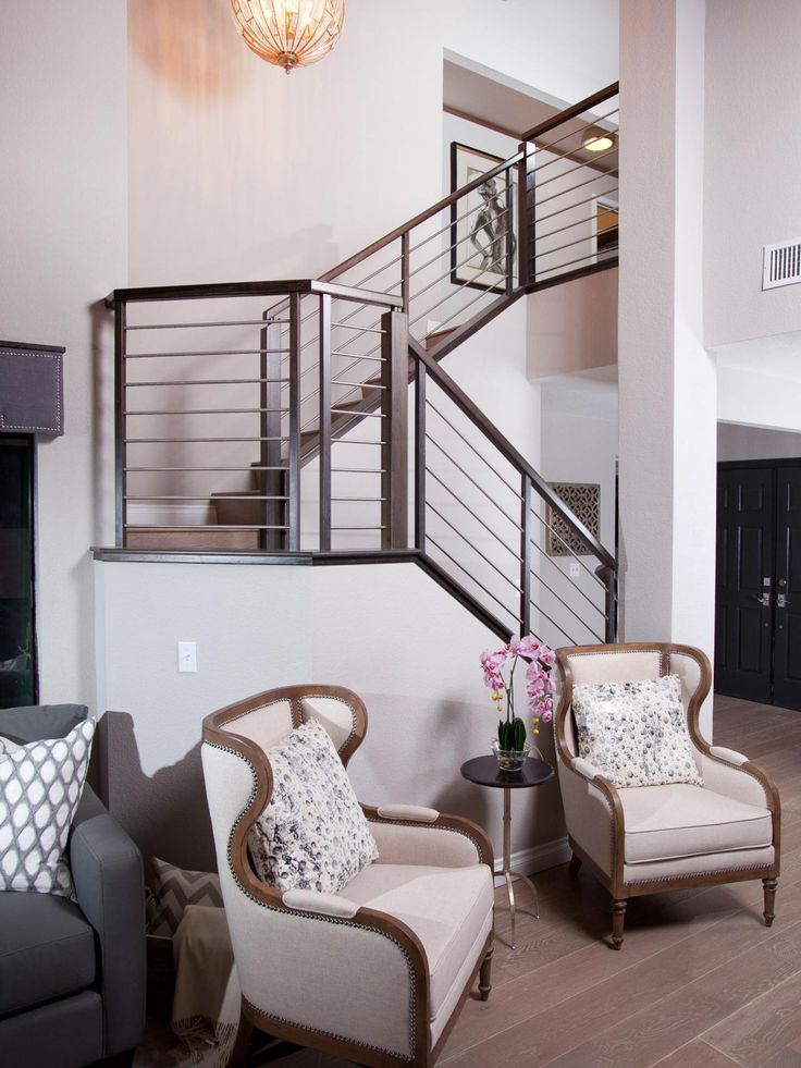 As seen on Brother Vs. Brother...The brushed steel banister on the stairway provides contrast against the light colored walls and brings attention to the soaring ceilings of Jonathan's finished room. #BroVsBro