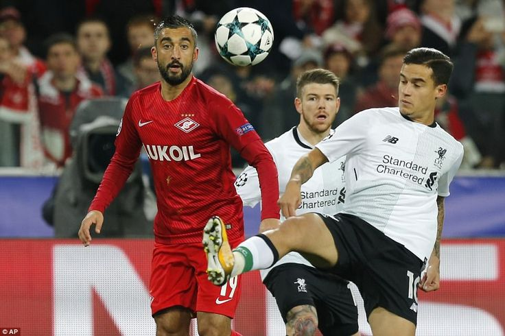 Alberto Moreno and Spartak's Aleksandr Samedov watch on as Coutinho attempts to bring a dropping ball under control