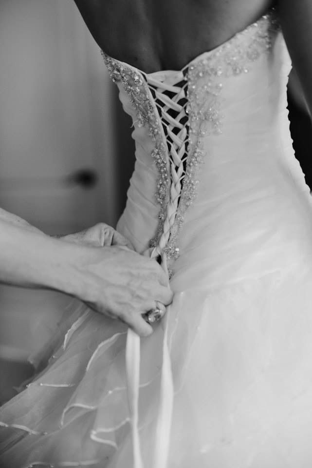 My dream wedding look is a fitted bodice with corset ties in the back and a princess style gown with barefeet and long blonde messy curls. <3