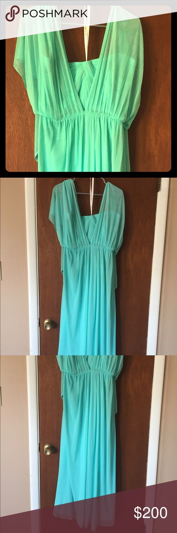 Teal Bridesmaid Dress. Worn once. Custom made so wearing a bra with straps is ok. Back has flowy sleeves down to waist. Size 18. Very comfortable and breezy. In the final photo you can see the glorious back in the reflection of the window David's Bridal Dresses Prom
