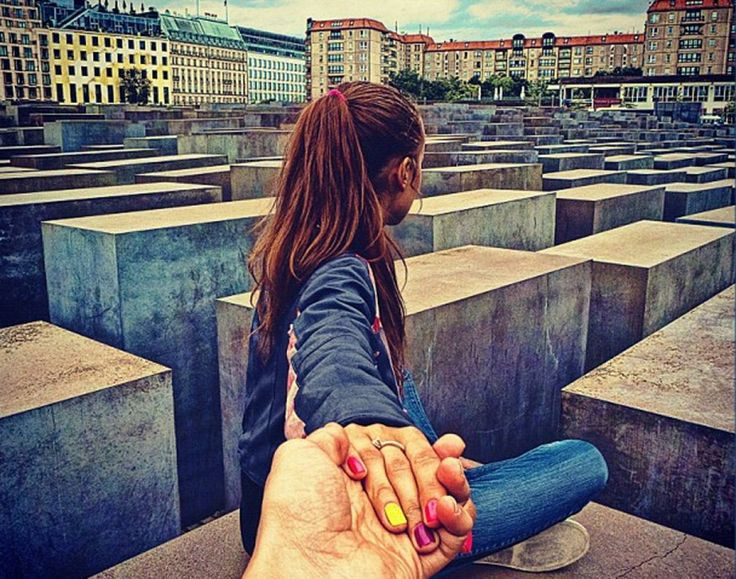 If you look closely, small details of Osmann's girlfriend's style are apparent in the series. She often has well-manicured nails and adorable outfits in the photographs. Here, she sits at the Holocaust Memorial in Berlin, Germany.