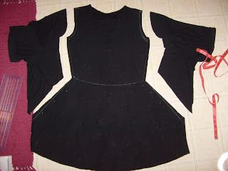 I love the outline of this dress & I am thinking, that I would keep it sleeveless & just add a ribbon sash!
