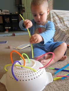 Fine Motor work: using pipecleaners and a colander (bending, sticking through holes)