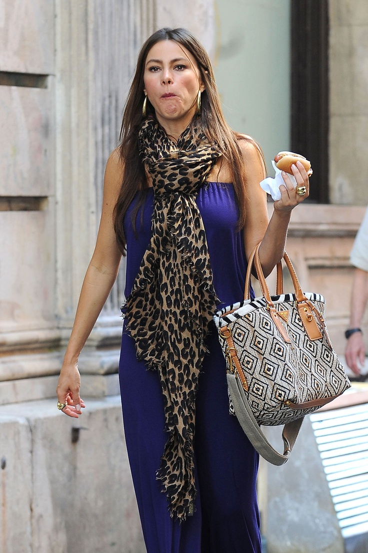 """""""The Three Stooges"""" star Sofia Vergara stops off for a New York City hot dog while out and about in a blue romper and leopard print scarf."""