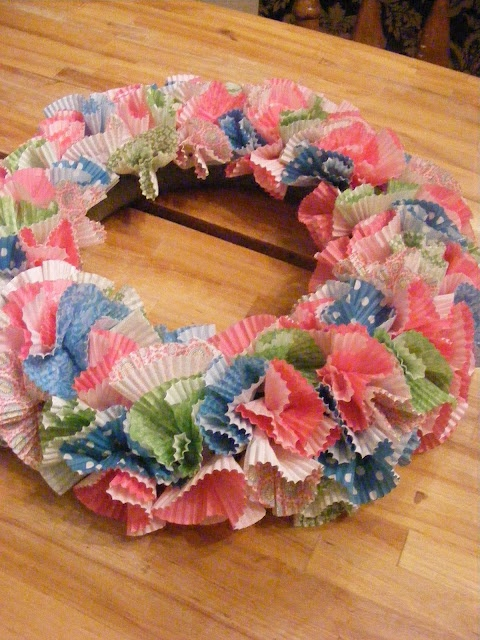 A Cheerful Wreath from Cupcake Liners  http://www.imperfecthomemaking.com/2012/02/cheerful-wreath-from-cupcake-liners.html