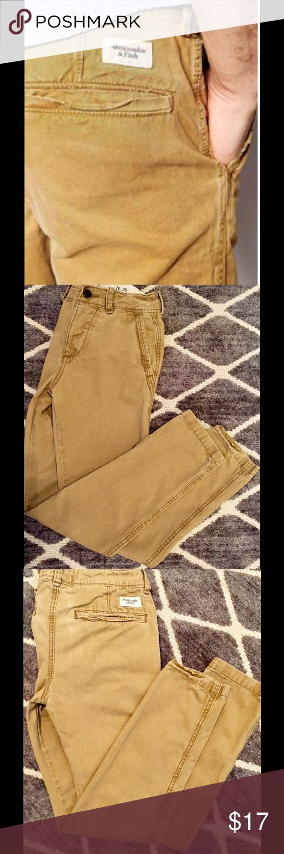 Abercrombie & Fitch Men's Skinny Chinos A classic chino pant with a skinny fit. Soft cotton blend, back pocket details with button closure, button fly. Subtle nicking and grinding at trims. Right coin pocket. Vintage wash in Khakis. Great condition men's A&F skinny chinos size 26W x 30L. Abercrombie & Fitch Pants Chinos & Khakis