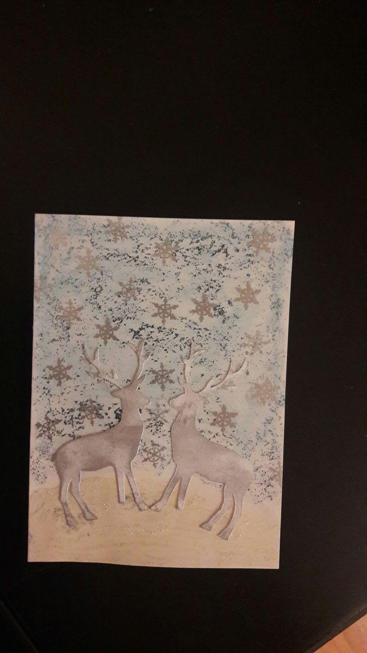 Julekort med reinsdyr og snøkrystaller