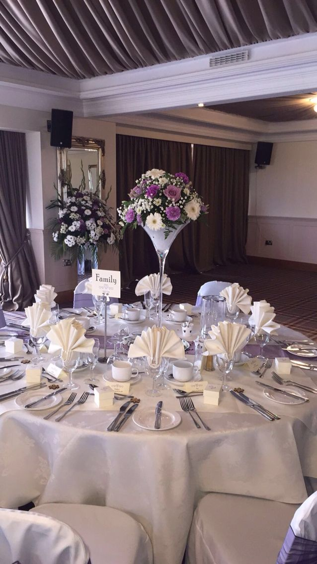 White gerbera and lilac flowers as centre table decorations