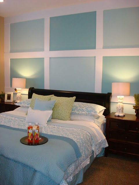I like the painted squares on one wall. My husband wants a blue room, so this could be a compromise!