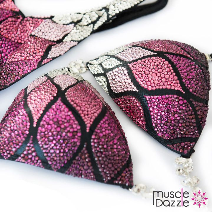 This custom figure posing suit features an elegant pattern of clear, pink and purple crystals on a black fabric. Custom made figure competition suit.  And don't forget to check out our full range of figure suits & competition bikinis at >> www.muscledazzle.com