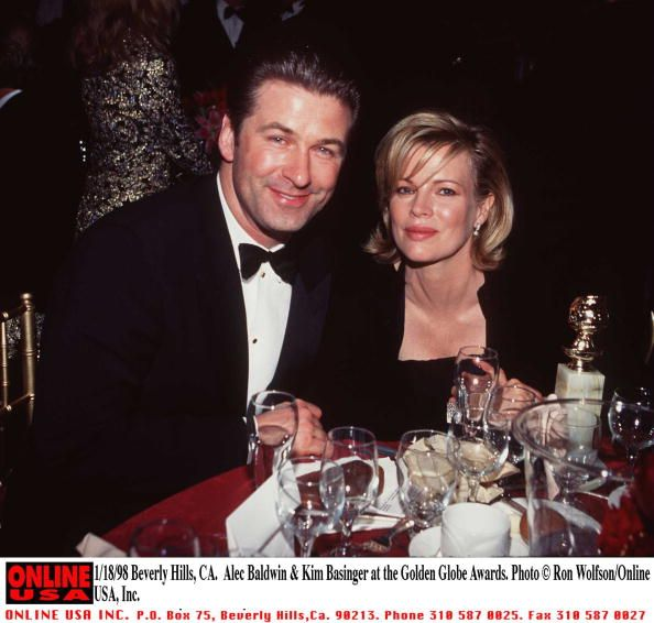 Married American Actors Alec Baldwin And Kim Basinger Sit At A Table During The Golden Globe