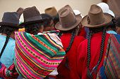 women with hats double pigtails Chincherro market nr Cusco Peru - Stock Photo
