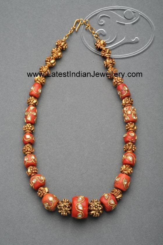 Stylish Coral Beads Necklace. Intricate Gold Work on the Corals Studded with Kundans enhances the look