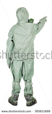 Man with protective mask and protective clothes directional pointing at distance looking away. Full body length portrait isolated over white studio background. - stock photo