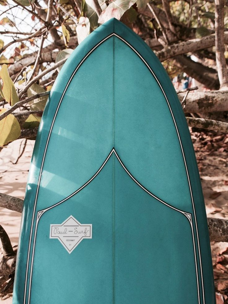 teal surfboard by paul surf