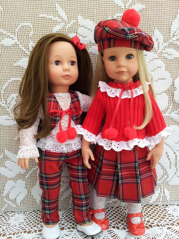 Red Tartan Scottish style outfits - pleat skirt, tartan trousers, beret & waistcoat. Red ribbed jumper with broderie anglaise & pompoms.  White Lace blouse & tartan scarf.