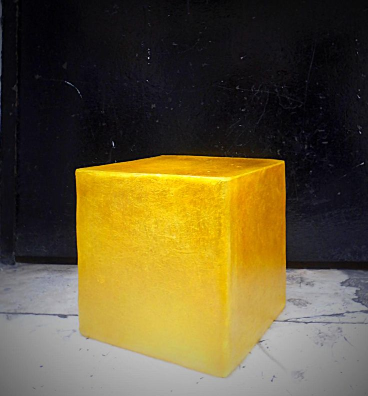 Lighting fixture in the shape of a cube, made out of fiberglass. It can be hung from the ceiling as the central lighting fixture of any space, or be put on any surface (table, shelf, floor) as a lamp standing on it own.  Dimensions: 20 x 20 cm  Fiberglass material is very lightweight, as well as very robust (it doesn't break easily!) so the cubes can be easily moved around.  Available in three colours: yellow gold, wine red and natural white.  They come complete with an E14 bulb holder.