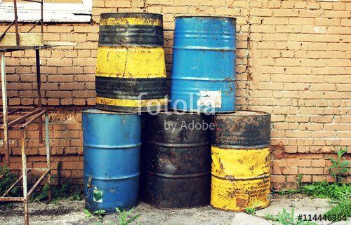 """Téléchargez la photo libre de droits """"Old dirty barrels of oil under in the industrial zone"""" créée par mg_54 au meilleur prix sur Fotolia.com. Parcourez notre banque d'images en ligne et trouvez l'image parfaite pour vos projets marketing !"""