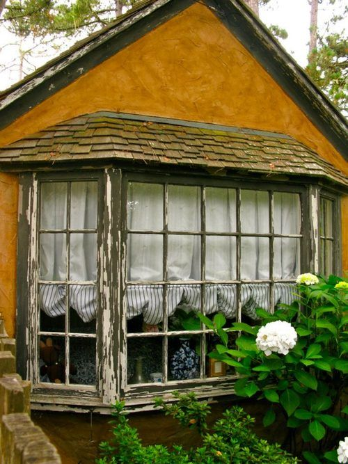 I'd love a window like that hopefully on the other side is a fireplace and pretty little tea setting :)