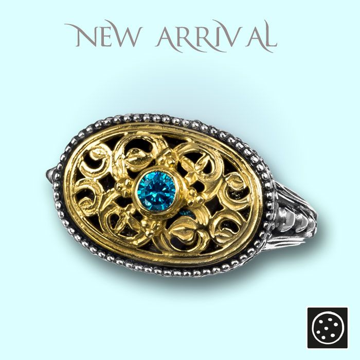 A new sterling silver ring with gold accents and blue zircon. Check out the link for more details and join our newsletter to get your exclusive discount.