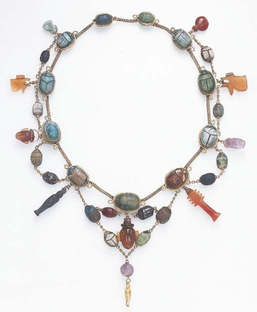 A NECKLACE OF ANCIENT EGYPTIAN AMULETS Middle Kingdom to Roman Period, 2040 B.C.-200 A.D. Necklace mounts circa 1920