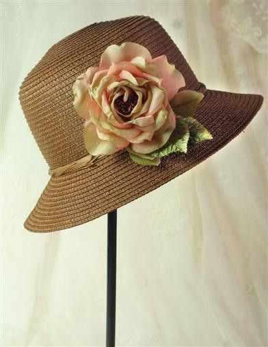 A perfect corsage rose is captured in silk, tinged with mint and blush. This detachable bloom adorns a sweet hat of syrup hue and will oblige sashes, cardigans and ponytails as well. Arrives in Keepsa