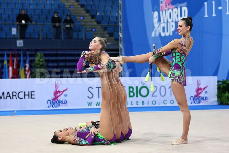 Ukraine's team performing the clubs routine during the FIG Rhythmic Gymnastic World Cup series Pesaro 2014.