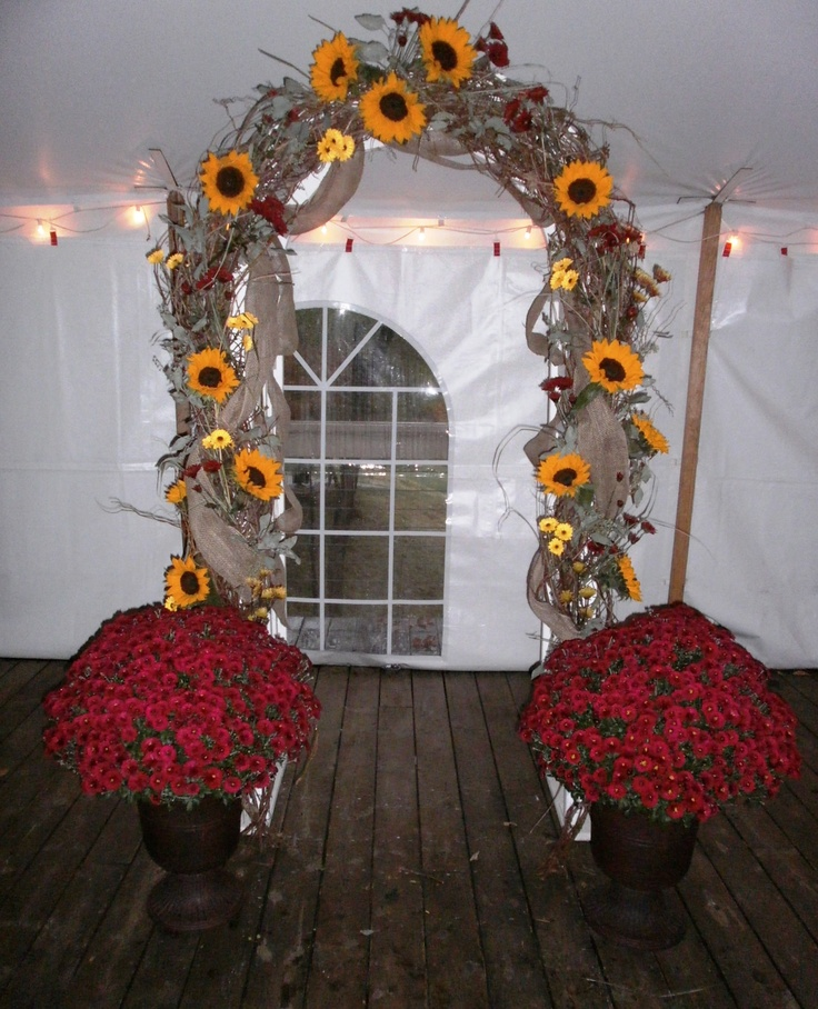 Grapevine Arch with sunflowers, mums and burlap designed  by Floralsbysharon for a  wedding at Yarrow Golf & Conference Center