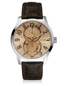 Montre Guess Homme multidateur dont le bracelet est en cuir marron. Cette montre Guess possède un boitier en acier.